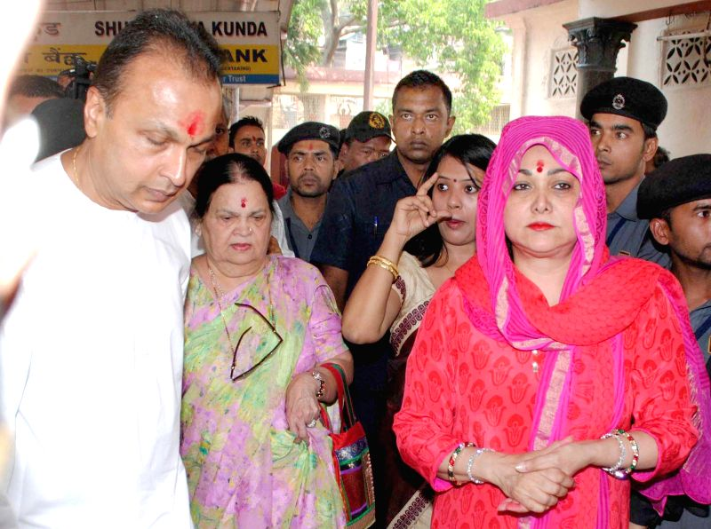 Reliance ADAG chairman Anil Dhirubhai Ambani, his wife Tina Ambani and his mother Kokilaben Dhirubhai Ambani during their visit to Kamakhya Temple in Guwahati on March 21, 2015. - Kokilaben Dhirubhai Ambani and Tina Ambani