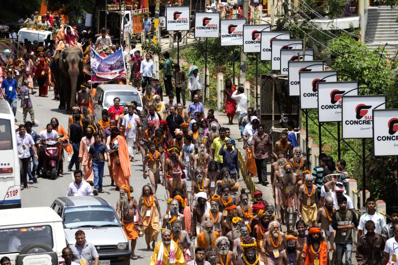 Sadhus from different parts of India praying and chanting mantras and devotional songs in the premises of Kamakhya temple on the eve of Ambubachi mela 2015 in Guwahati on June 21, 2015.