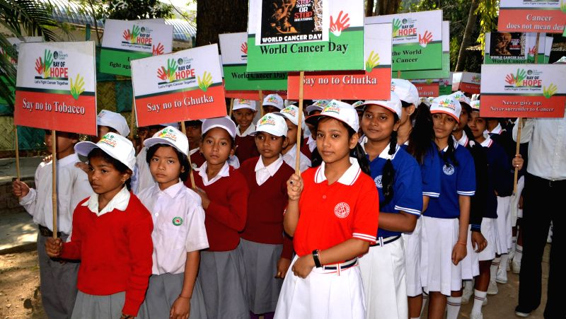 Schools children participate in a Cancer Awareness rally on the occasion of `World Cancer Day`, in Guwahati on Feb. 4, 2015.