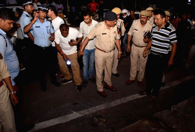 Guwahati: Security officials inspect the blast site where five persons were reportedly injured outside a shopping mall in Guwahati on May 15, 2019.