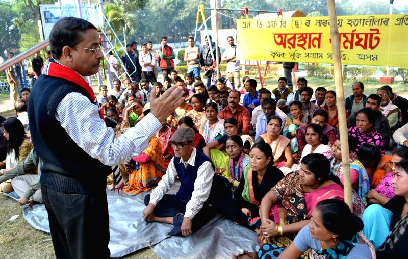 Social activist Loknath Goswami addresses during a sit-in demonstration organised by KMSS to protest against the recent Assam violence that left 73 people dead, in Guwahati, on Dec 26, ... - Loknath Goswami