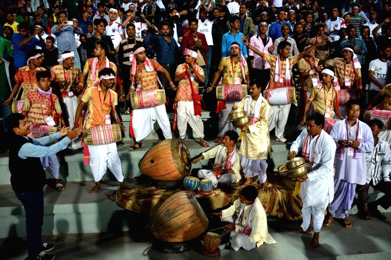 Supporters of NorthEast United FC play dhols in traditional Assamese attire during an ISL match between NorthEast United FC and Delhi Dynamos FC at Indira Gandhi Athletic Stadium in ...