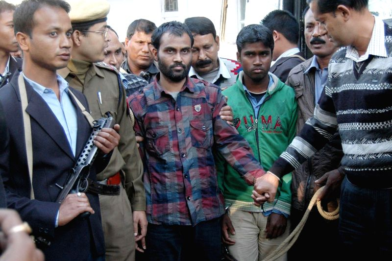 The accused in Burdwan blast, Nur Jamal Haque and Sahanur Alom being taken to be produced at Guwahati Court on Dec 20, 2014.