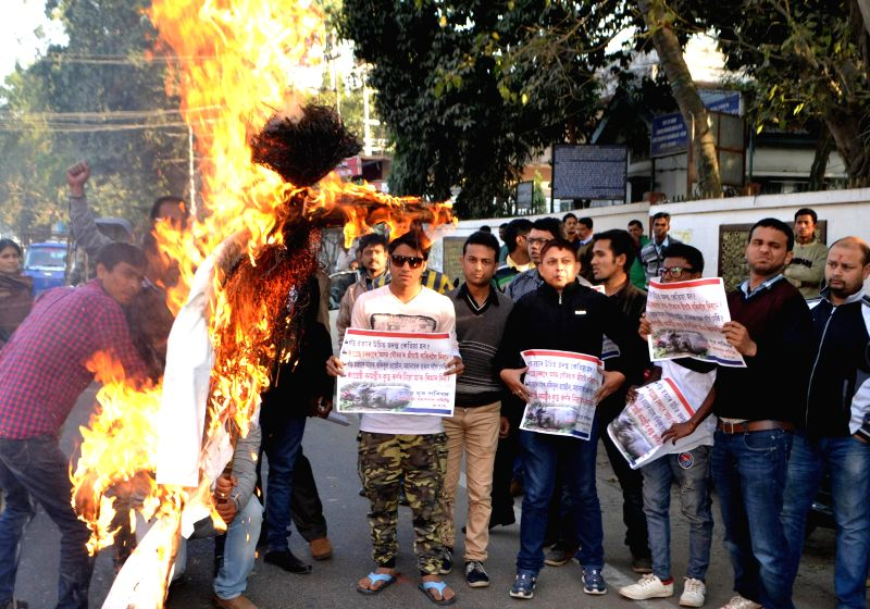 The activists of Asom Yuva Parishad (AYP) burn an effigy of Assam Forest Minister Rockybul Hussain during a protest against the recent cases of Rhino killing in Assam, in Guwahati on Jan ... - Rockybul Hussain