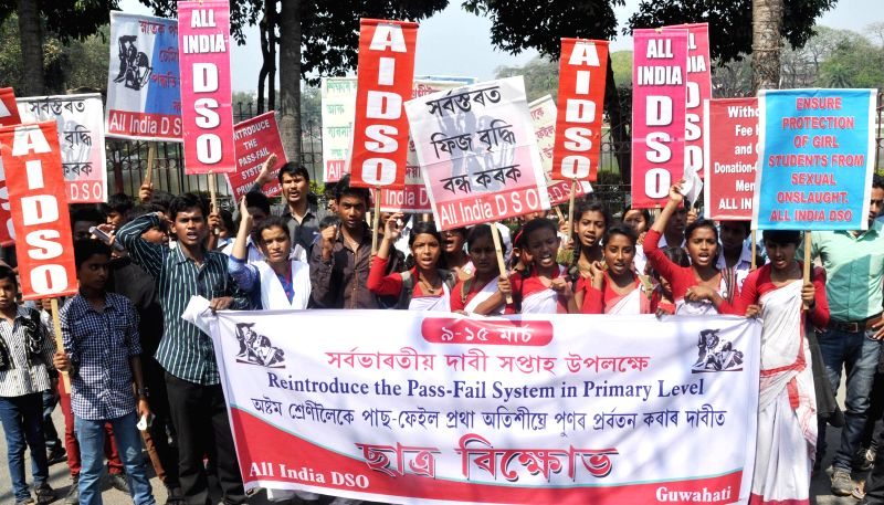 The activists of the All India Democratic Students' Organization (AIDSO) participate in a procession to press for reintroduction of Pass-Fail System at Primary Level in Guwahati, on March ...