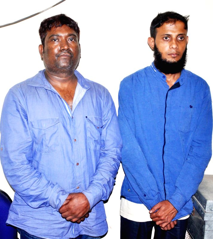 The two alleged car thieves Anil Chauhan (L) and Mamun Chaudhary (R), who were apprehended by the Guwahati police being presented before press in Guwahati, on April 3, 2015. - Chauhan and Mamun Chaudhary
