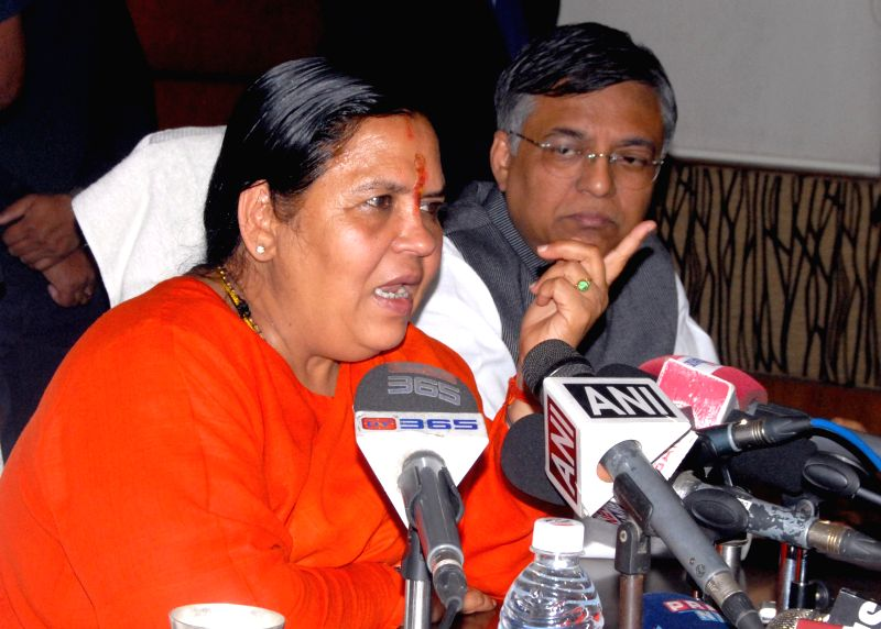 Union Minister for Water resource, River Development and Ganga Rejuvenation Uma Bharti and Assam BJP chief siddharth bhattacharya during a press conference in Guwahati, on Feb 10, 2015.