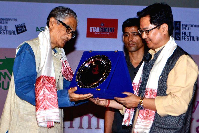 Union MoS Home Affairs Kiren Rijiju felicitates filmmaker Abdul Majid during Brahmaputra Valley Film Festival 2015 in Guwahati, on April 26, 2015.