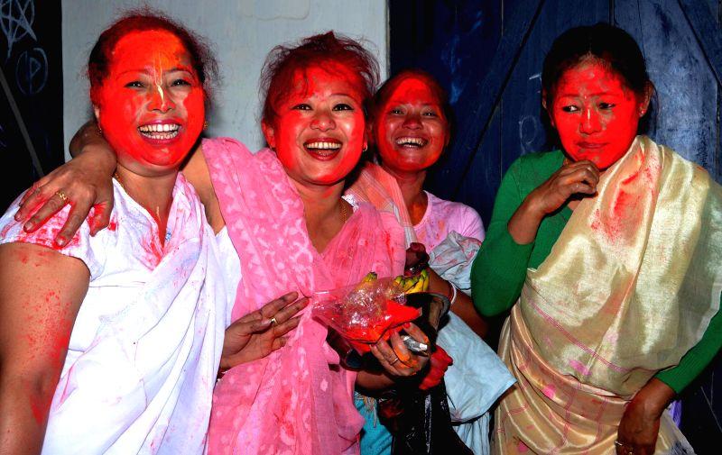 Women celebrate Holi in Manipur Basti of Guwahati on March 6, 2015.