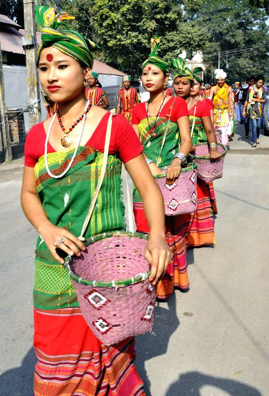 Women of Rava tribe of Assam participate in a cultural procession organised during Assam Sanskriti Mahotsav - 2014 in Guwahati, on Nov 18, 2014.