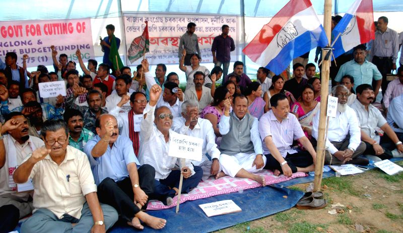 Workers of Asom Gana Parishad CPI, CPI(M) SP, NCP, CPI(ML), GANASKTI, UPF, HSDP, and other parties stage a demonstration against the ruling Congress party in the state and the betrayal of ...