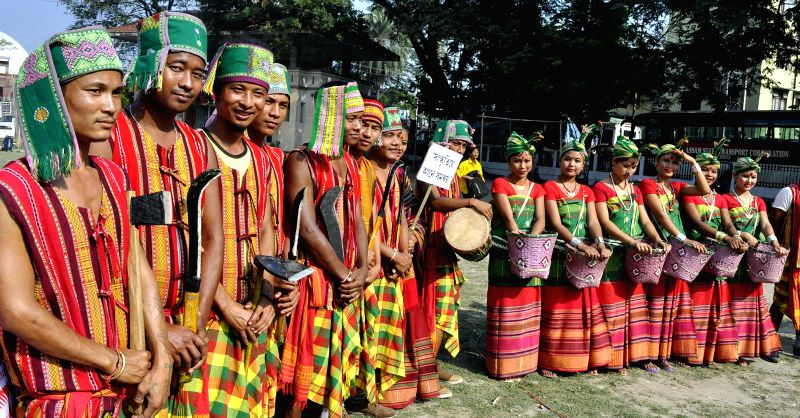 Youths of Rava tribe of Assam participate in a cultural procession organised during Assam Sanskriti Mahotsav - 2014 in Guwahati, on Nov 18, 2014.
