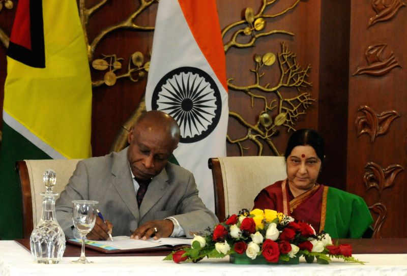 Guyana's Vice President and Minister of Foreign Affairs Carl B. Greenidge and External Affairs Minister Sushma Swaraj at the signing ceremony in New Delhi on Jan 30, 2018. - Sushma Swaraj