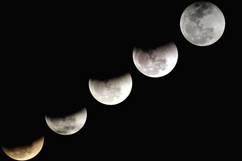 GWADAR (PAKISTAN), Jan. 31, 2018 Combo photo taken on Jan. 31, 2018 shows different shapes of the moon during a lunar eclipse in southwest Pakistan's Gwadar.