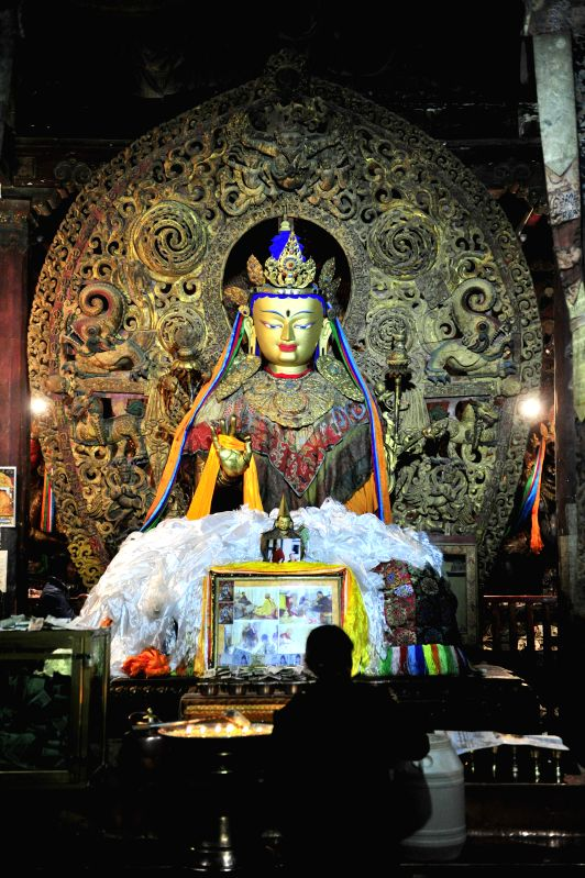 Photo taken on Aug. 14, 2014 shows a figure of Buddha within the Baiqoi Monastery in Gyangze County, southwest China's Tibet Autonomous Region. The monastery, which