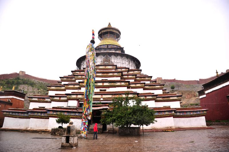 Photo taken on Aug. 14, 2014 shows the tower of the Baiqoi Monastery in Gyangze County, southwest China's Tibet Autonomous Region. The monastery, which dates back ..