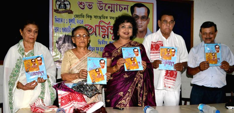 Gyansree Pathak and Satyasree Das with other dignitaries during launch of 'Agnisur' - an audio CD at Press Club in Guwahati on July 1, 2014. - Gyansree Pathak