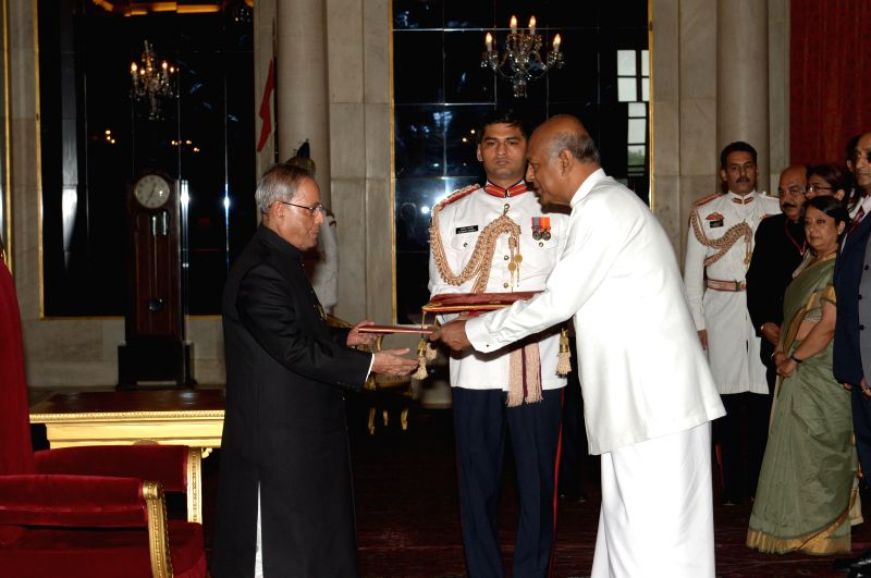 H.E. Prof. Sudharshan Seneviratne, High Commissioner-designate of Sri Lanka presents his credentials to President Pranab Mukherjee at Rashtrapati Bhawan in New Delhi on July 31, 2014.