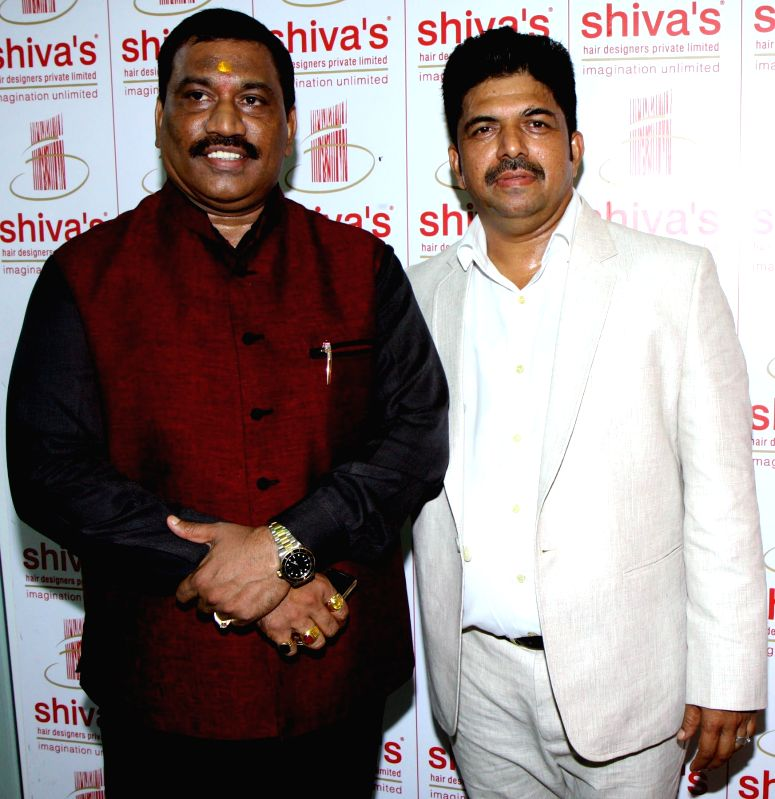 H S Patil & Shivarama Bhandary during the opened Shivarama K Bhandary`s sixth hair design saloon in Mumbai on June 30, 2014. - H S Patil