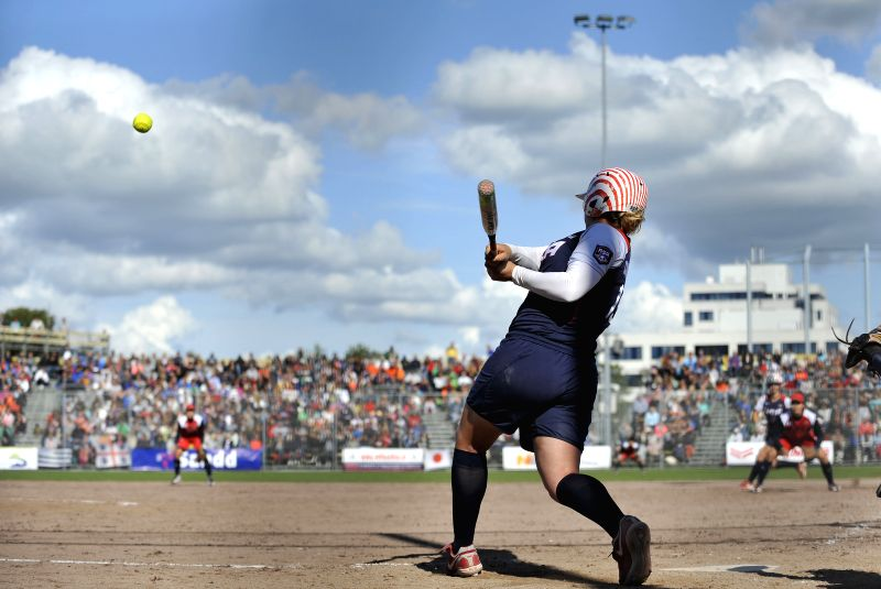 Amanda Chidester of the United States hits the ball during the final against Japan at 2014 Women's World Softball Championship in Haarlem, the Netherlands, Aug. 24,