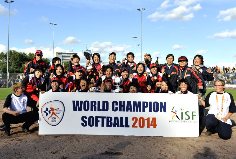 Japanese team pose for photos after winning the final against the United States at 2014 Women's World Softball Championship in Haarlem, the Netherlands, Aug. 24, ...