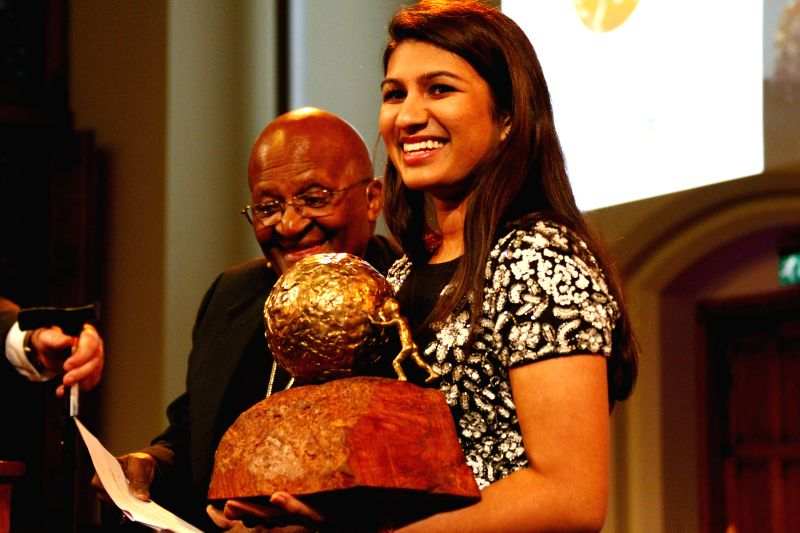 Hague (Netherlands): Neha Gupta accepts the 10th International Children's Peace Prize in the Hague, the Netherlands, Nov. 18, 2014. This year's International Children's Peace Prize was awarded to ... - Neha Gupta