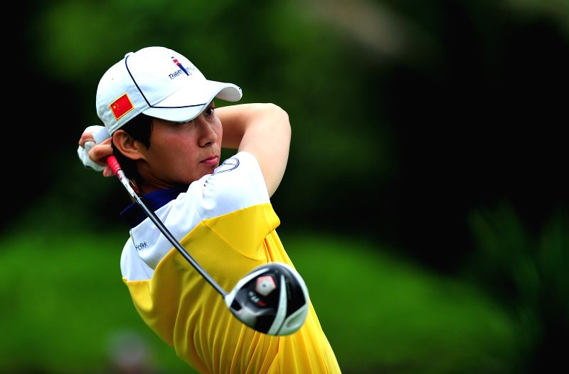 Li Xinyang of China competes in the 2014 China Tour-PGA Tour China Series Mission Hills Haikou Open in Haikou, capital of south China's Hainan Province, April 17, ..