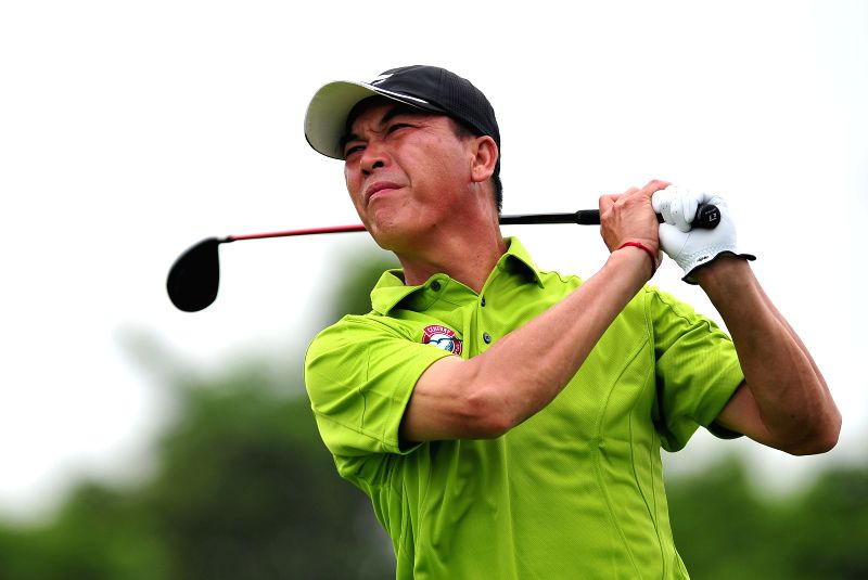 Zhang Lianwei of China competes in the 2014 China Tour-PGA Tour China Series Mission Hills Haikou Open in Haikou, capital of south China's Hainan Province, April ...