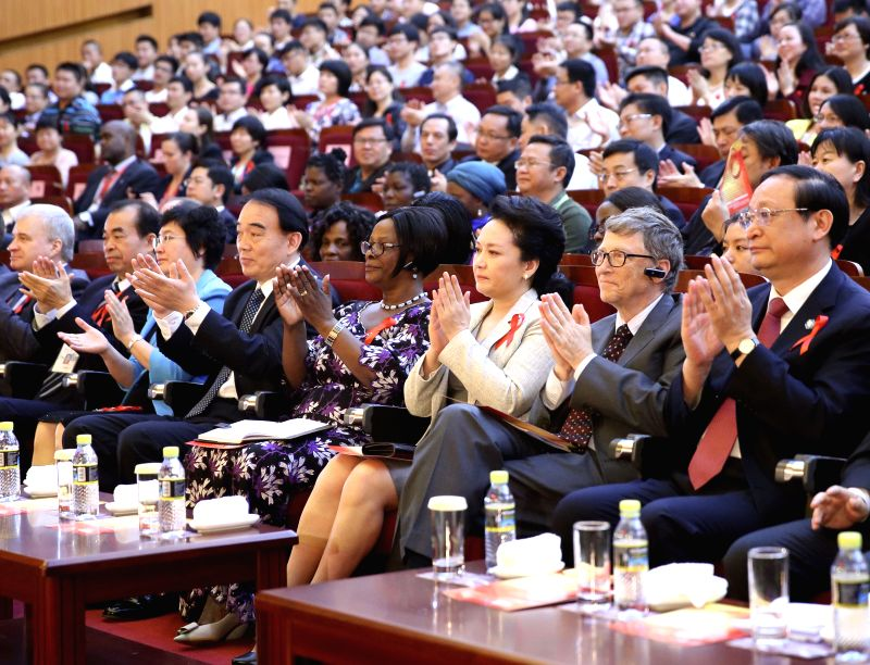 Chinese President Xi Jinping's wife Peng Liyuan (3rd R front), who is the World Health Organization (WHO)'s goodwill ambassador for tuberculosis and HIV/AIDS, ...