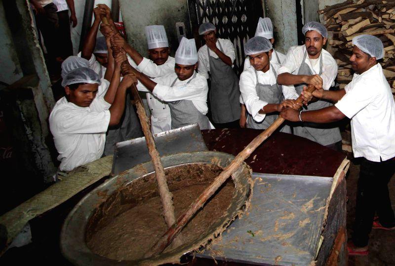 Haleem preparation by workers.