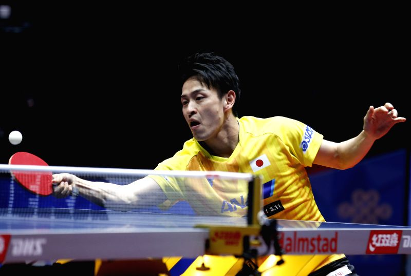 Oshima Yuya of Japan returns to Beh Kun Ting of Singapore at the fifth round of Men's group match during the 2018 World Team Table Tennis Championships in Halmstad Sweden