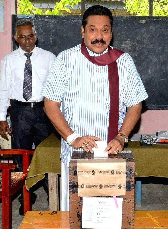 Sri Lankan President Mahinda Rajapaksa casts his vote at a polling station in Tangalle, Hambantota, Sri Lanka, Jan. 8, 2015. Sri Lanka held presidential election .