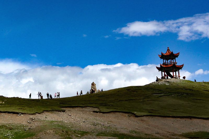 HAMI, May 30, 2017 - Tourists visit the Tianshan mountain scenic area in Hami, northwest China's Xinjiang Uygur Autonomous Region, May 29, 2017.