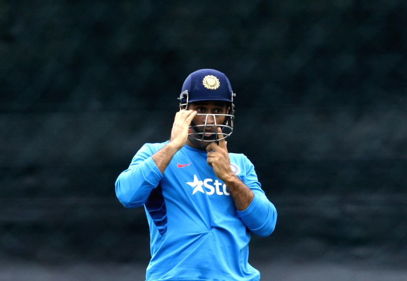 Indian captain M S Dhoni during a practice session ahead of an ICC World Cup - 2015 match against Ireland at the Seddon Park in Hamilton, New Zealand  on March 9, 2015. - M S Dhoni