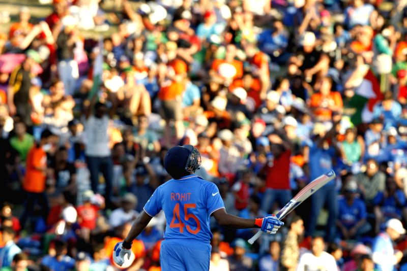 Hamilton (New Zealand): Indian batsman Shikhar Dhawan celebrates after scoring half century during an ICC World Cup - 2015 match against Ireland at the Seddon Park in Hamilton, New Zealand  on March ... - Shikhar Dhawan