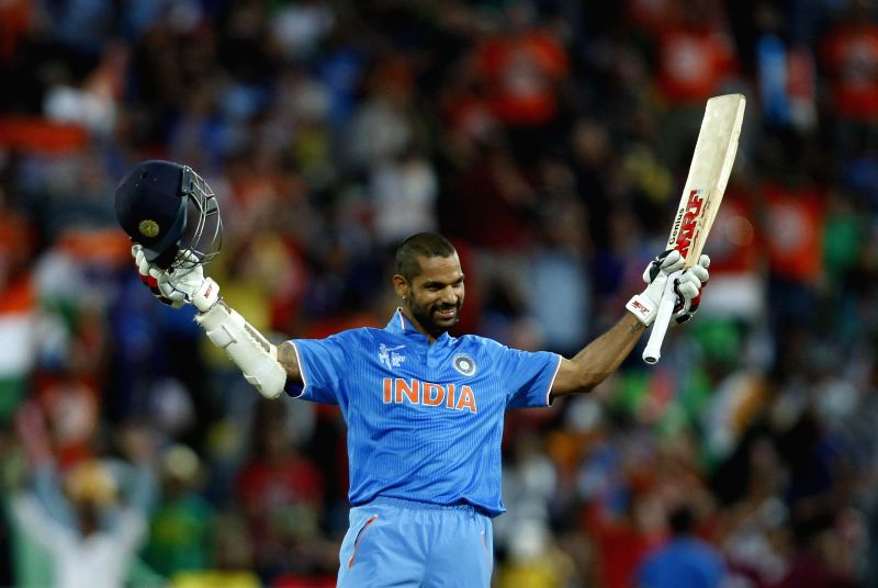 Hamilton (New Zealand): Indian batsman Shikhar Dhawan celebrates his century during an ICC World Cup - 2015 match against Ireland at the Seddon Park in Hamilton, New Zealand  on March 10, 2015. - Shikhar Dhawan