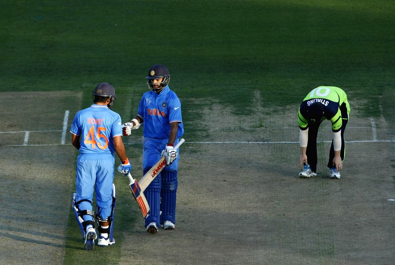 Hamilton (New Zealand): Indian batsmen Rohit Sharma and Shikhar Dhawan in action during an ICC World Cup - 2015 match against Ireland at the Seddon Park in Hamilton, New Zealand  on March 10, 2015. - Shikhar Dhawan and Rohit Sharma