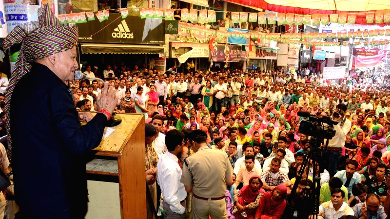 Himachal Pradesh Chief Minister Virbhadra Singh addresses during a public meet at Hamirpur on April 11, 2015. - Virbhadra Singh