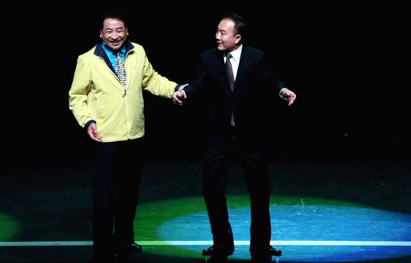 HANAU, April 30, 2017 - Chinese cross talk artists Jiang Kun (L) and Dai Zhicheng perform during a cross talk show at the Congress Park Hanau near Frankfurt, Germany, on April 29, 2017. (Xinhua/Luo ...