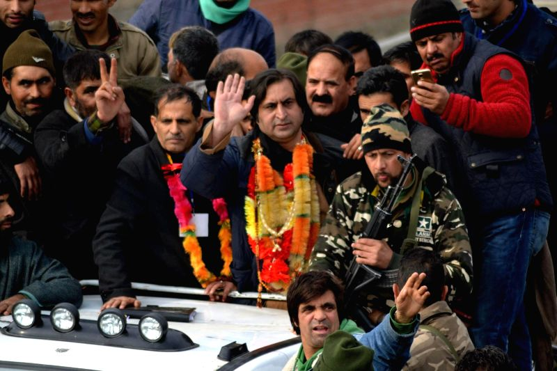 People`s Conference leader Sajjad Gani Lone during a rally organised after he was declared victorious from Handwara constituency in the recently held Jammu and Kashmir .