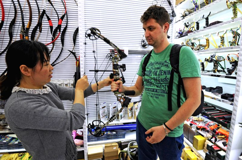 HANGZHOU, April 21, 2017 - Vendor Wu Haiying introduces fitness bows to a Romanian businessman Grigore Lama at a market in Yiwu, east China's Zhejiang Province, April 13, 2017. According to Hangzhou ...