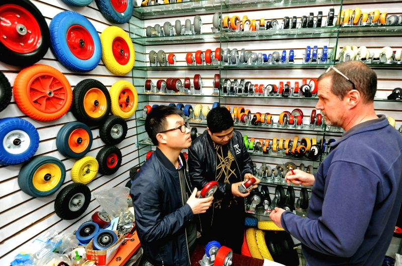 HANGZHOU, April 21, 2017 - Vendors introduce automotive parts to an American businessman at a market in Yiwu, east China's Zhejiang Province, April 13, 2017. According to Hangzhou customs, Zhejiang's ...