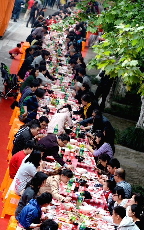 "People have a dinner at a ""cattle feast"" in Hangzhou, capital of east China's Zhejiang Province, April 26, 2014. The cattle feast, which was made with ."