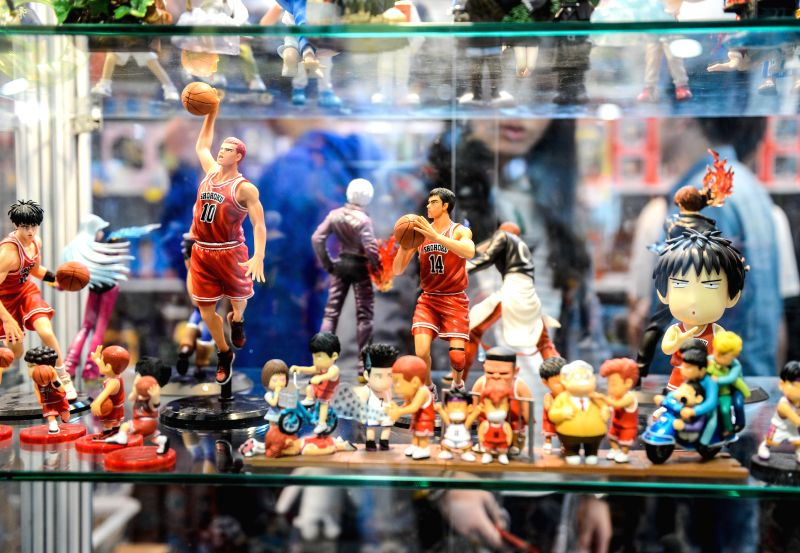 Visitors view cartoon models during the 10th China International Cartoon & Animation Festival (CICAF) in Hangzhou, capital of east China's Zhejiang Province, .