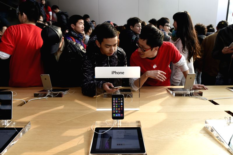 Customers shop in a new Apple Store in Hangzhou, capital of east China's Zhejiang Province, Jan. 24, 2015. Hangzhou's first Apple Store went into business on ...