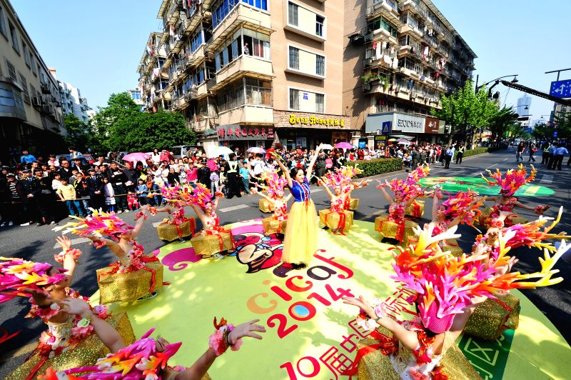 People take part in a parade during the 10th China International Cartoon and Animation Festival in Hangzhou, capital of east China's Zhejiang Province, May 1, 2014, .