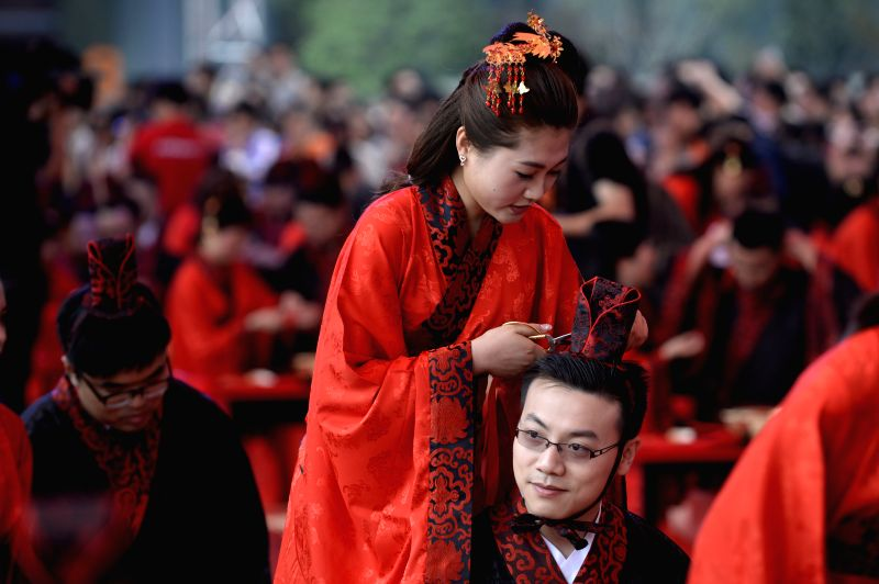 Newlyweds attend a group wedding ceremony at the headquarters of the Chinese Internet giant Alibaba Group in Hangzhou, capital of east China's Zhejiang Province, May