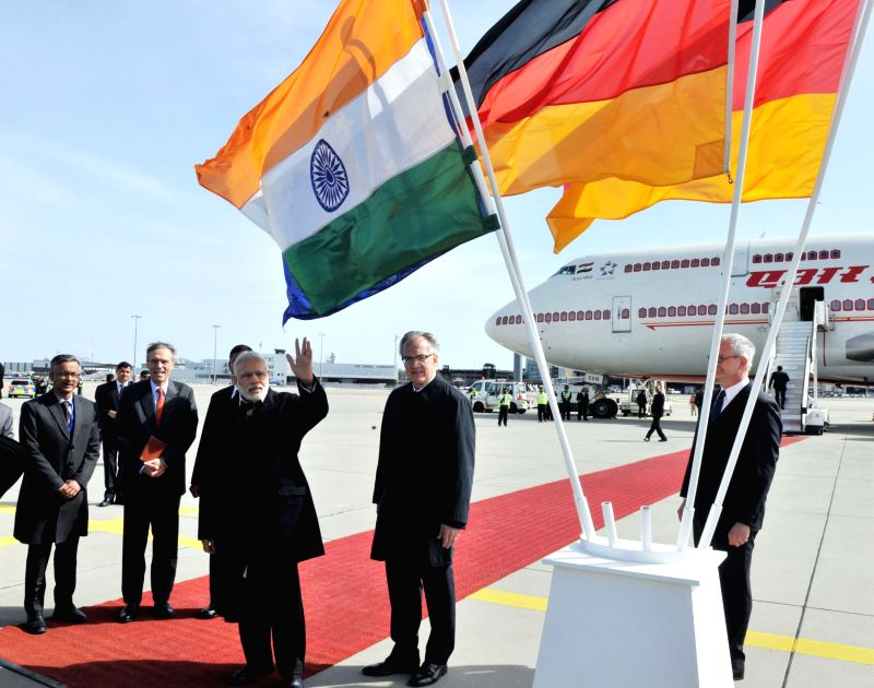 Hannover (Germany): Prime Minister Narendra Modi being received by the German Ambassador to India Michael Steiner on his arrival, at Hannover Airport, in Germany on April 12, 2015. - Narendra Modi