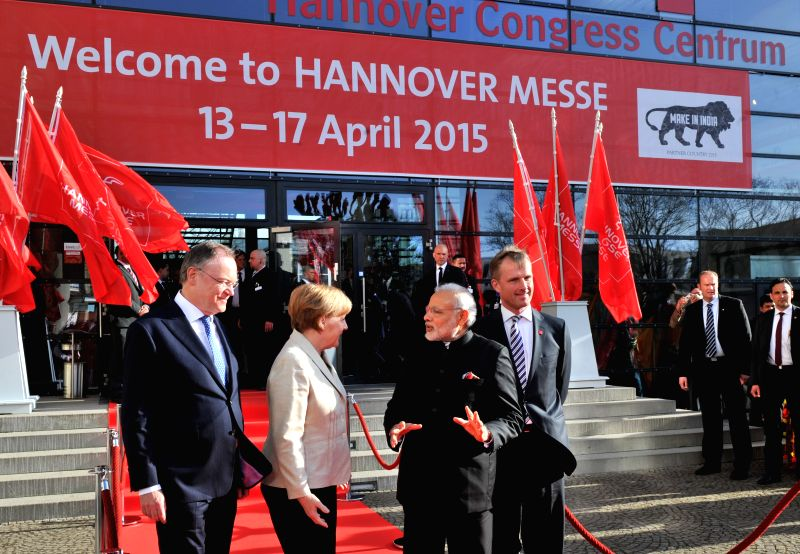 Hannover (Germany): Prime Minister Narendra Modi with German Chancellor Dr. Angela Merkel at Hannover Congress Centre for the Inaugural Ceremony of the Hannvoer Messe in Germany on April 12, 2015. - Narendra Modi