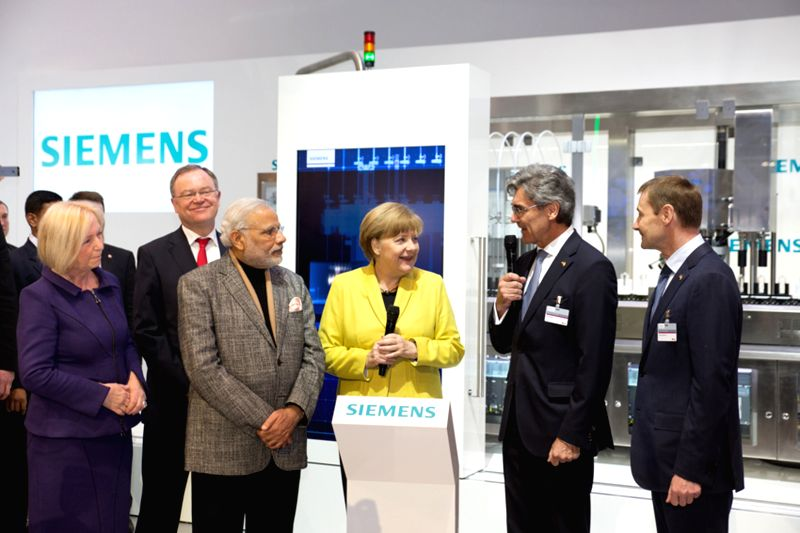 Hannover (Germany): Prime Minister Narendra Modi and Chancellor of Germany Angela Merkel visit the Siemens AG booth at  Hannover Messe 2015 in Germany on April 13, 2015. - Narendra Modi